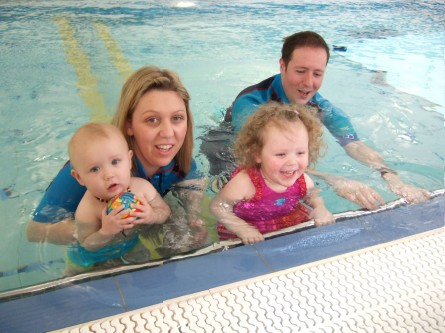 Aqua babies family picture in swimming pool
