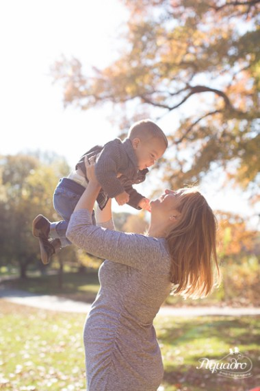 Expecting mom lifts 2 year old son above head in Prospect Park, Brooklyn