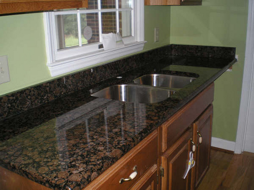 Right Colors To Complement Your Granite - Aqua Granite on Black Granite Countertops With Brown Cabinets  id=36598
