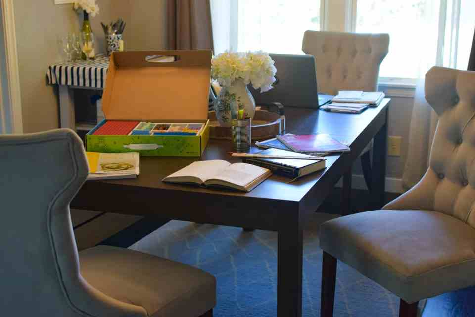 a kitchen table filled with homeschool items