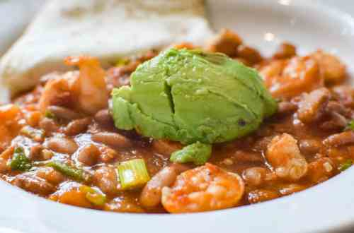 shrimp and pinto beans in a white bowl