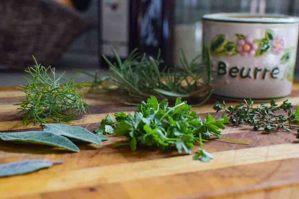 herbs chopped up on a cutting board