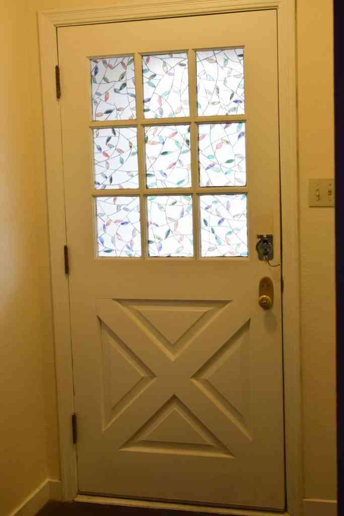 a plain white entry door before dry brushing