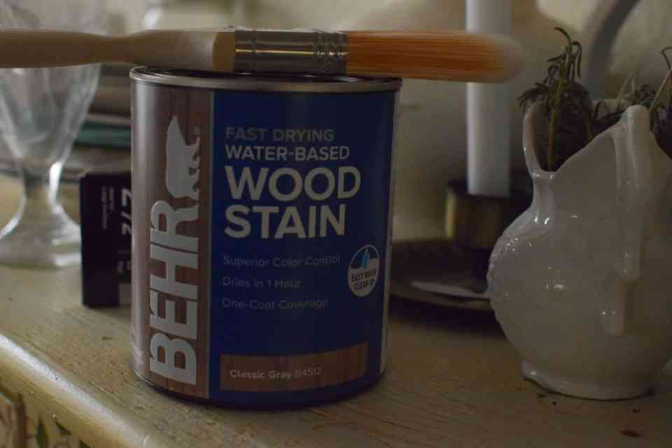can of wood stain and a paint brush for dry brushing