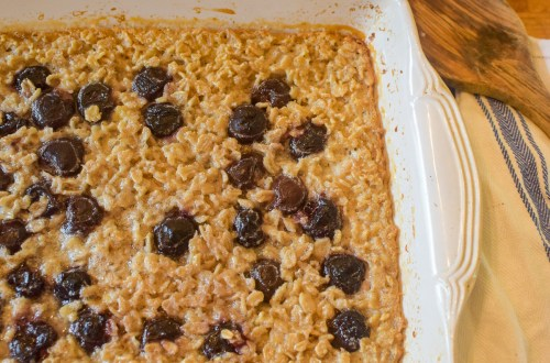 a dish with cherry oatmeal bake inside