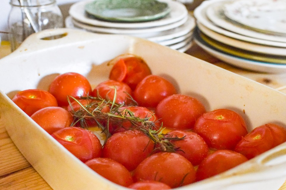 dish of tomatoes to be preserved in olive oil