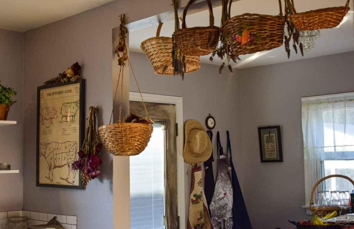 home decor baskets hanging inside an old world kitchen