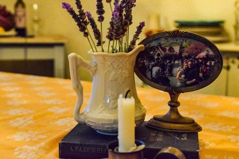an old frame and pitcher with lavender showing a french or old world  farmhouse look