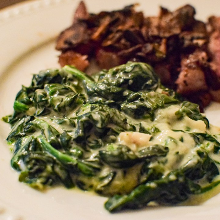 creamed spinach on a white plate