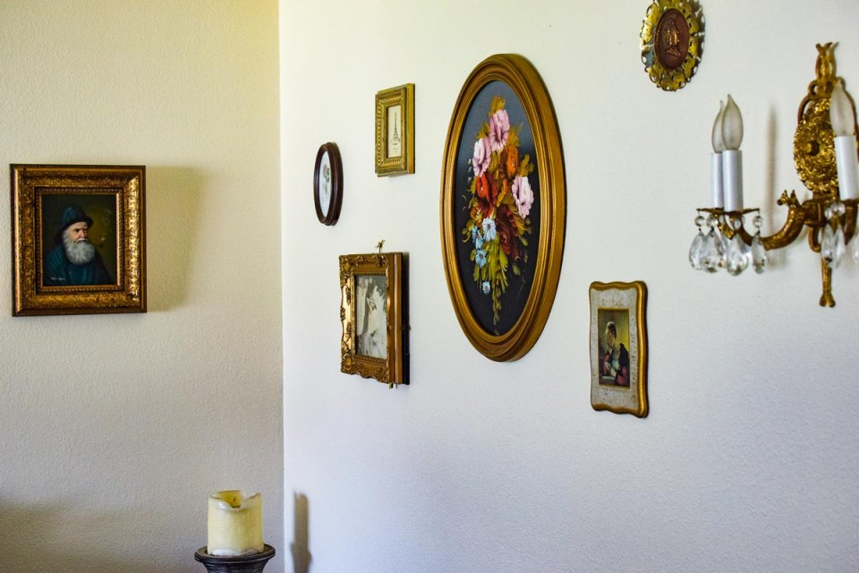 oil paintings hung on a old world styled wall