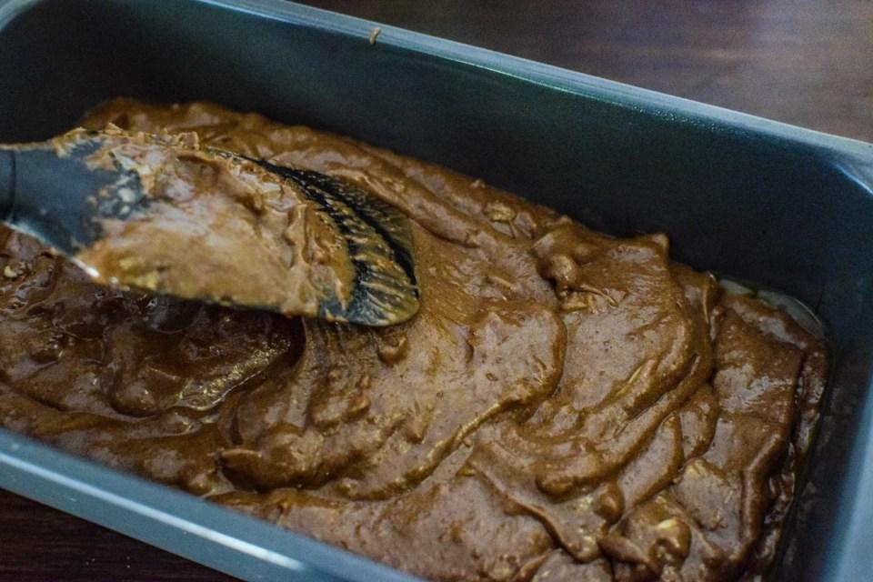 chocolate walnut loaf batter inside loaf pan