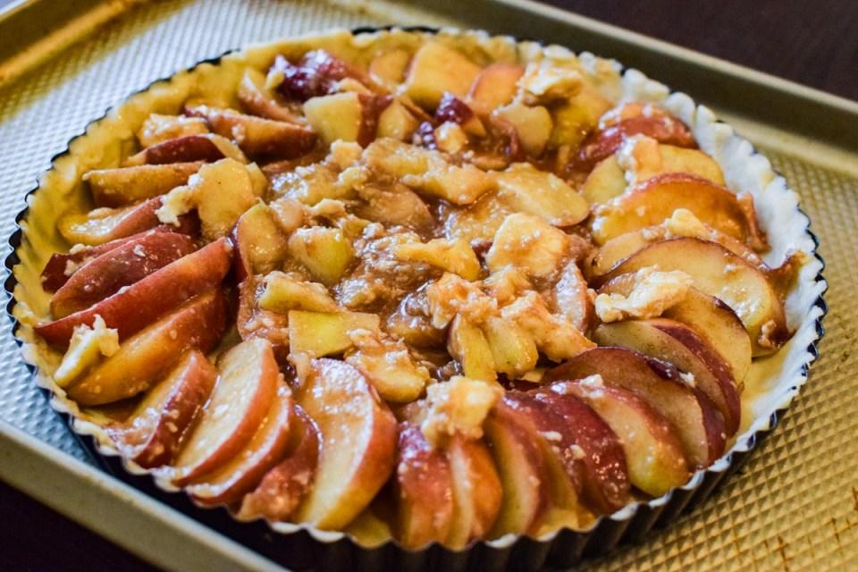 peach tart recipe ready to be baked
