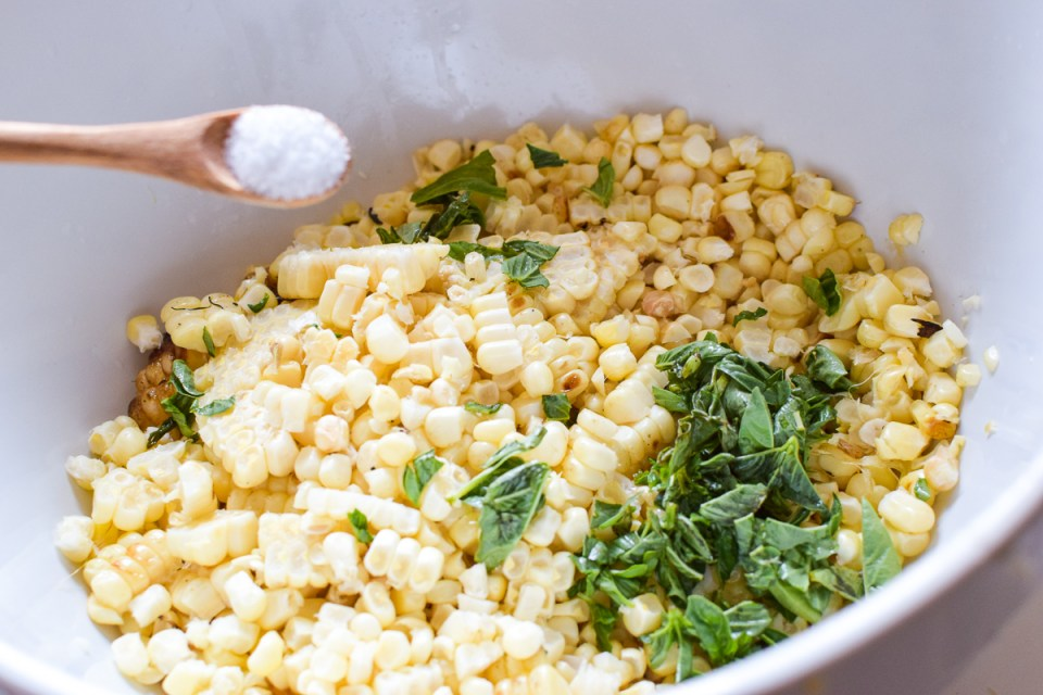 roasted sweet corn with basil in a bowl