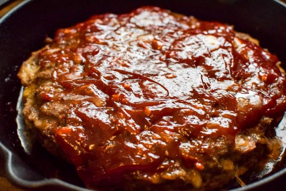 glazed meatloaf in a cast iron skillet