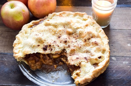 old fashioned apple pie with a candle