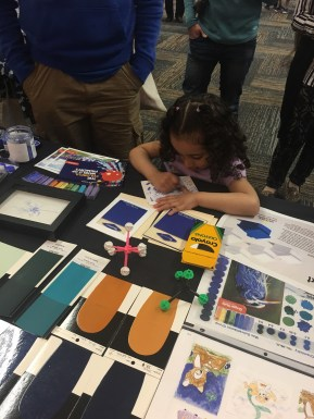 Kids at the event trying out the new sample crayon…