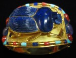 ori__2003514750_1107428_Gold,_Lapis,_Carnelian,_and_Turquoise_Uraeus_Bracelet_in_the_Style_of_Tutankhamun_-_FJ.0005