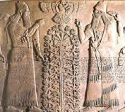 Gryphons-dating-from-before-2000-BCE-two-of-them-shown-in-company-with-the-Sumerian-deity-Ningishzida-Meso-Tree-of-Life