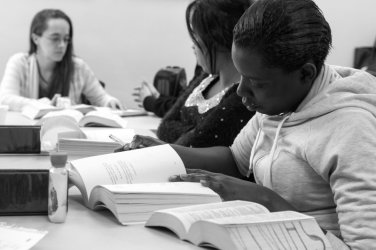 """In November 2013, at a reading circle called Women Moving Forward, the participants are reading """"Burned"""" by Ellen Hopkins. Photo by Literature for Life volunteer photographer, Marie Andree Robert."""