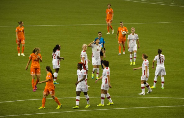Half the CanWNT mixed in with the Netherlands for a corner kick.