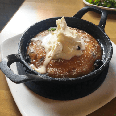 Blueberry skillet pancake with maple syrup and creme fraiche at The Craft - Brasserie & Grille. Photo by: @daniellefinest of @tofoodies.