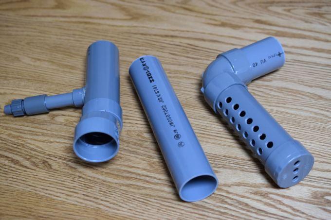 S型ソケットと給水用の塩ビ接続パーツを接着したピストル管、排水管、シャワーパイプ