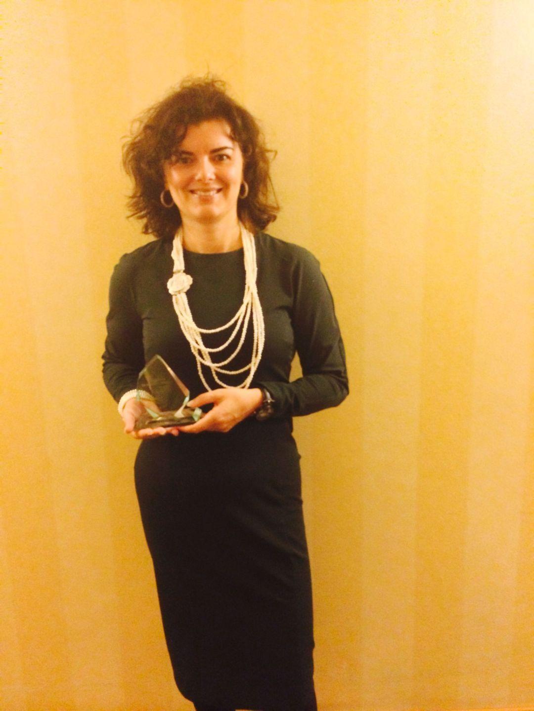 María Luisa de Miguel con el Premio EMCC