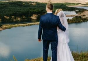 Married  couple on mountain overlooking ocean