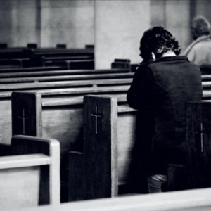 Man repenting in church