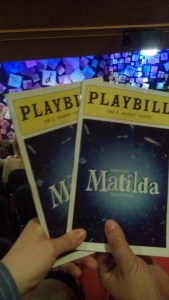 Holding our Playbills in front of the Matilda stage
