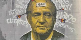 La pena de prisión para Pablo Hasel ha motivado nuevas pintadas contra el rey emérito Juan Carlos, como este mural en Barcelona