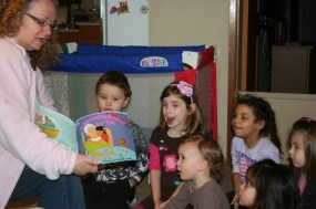 Irvina reading with children at A Quiet Forest Daycare and Preschool in Duvall, WA.
