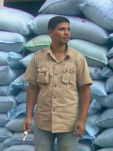 man in front of blue sand bags in Cairo