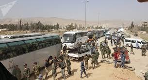 مركز المصالحة الروسي: خروج 4 آلاف مسلح وأسرهم من الغوطة الشرقية