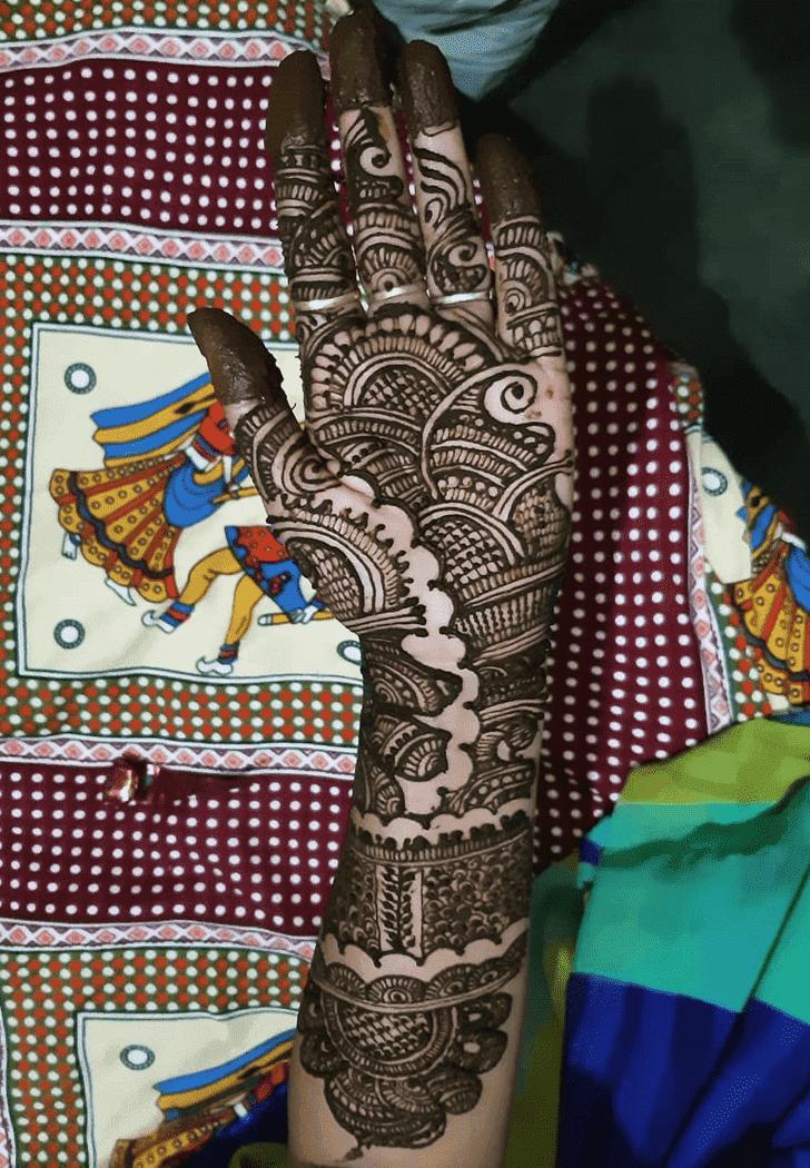 Alluring Raksha Bandhan Henna Design on Back hand