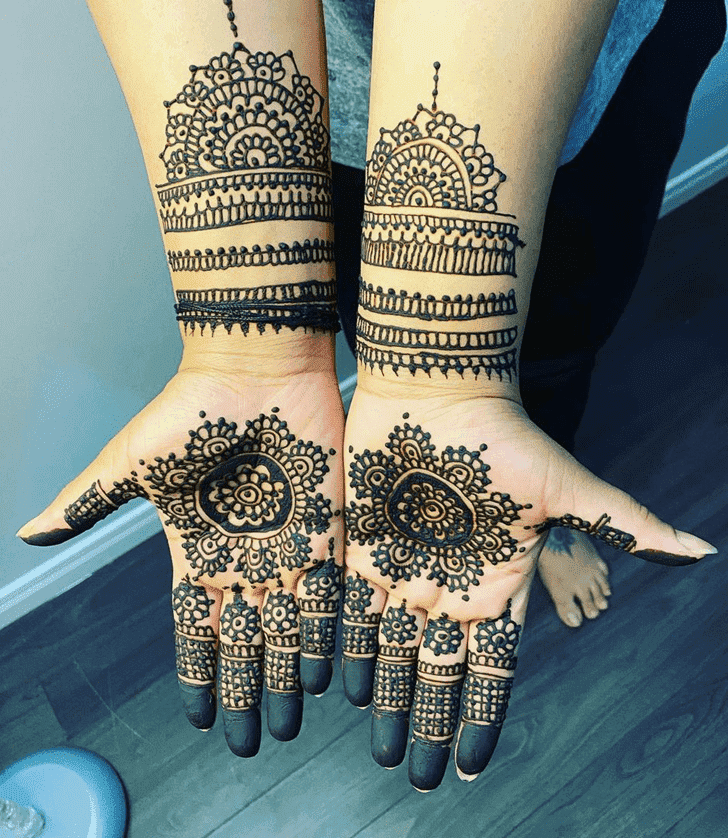 Appealing Raksha Bandhan Henna Design on Back Hand