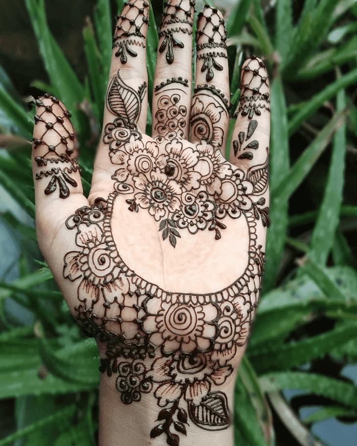 Bewitching Raksha Bandhan Henna Design on Back Hand