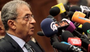 Amr Moussa, chairman of the committee to amend Egypt's constitution speaks at a news conference at the Shura Council in Cairo