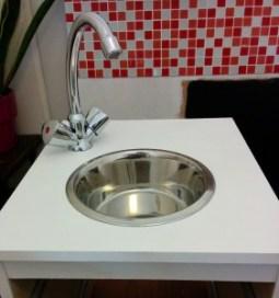 fixation robinet évier