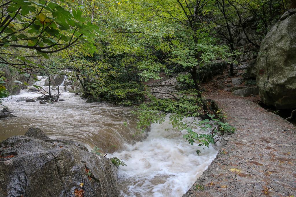 A stone bridge over a rushing creek