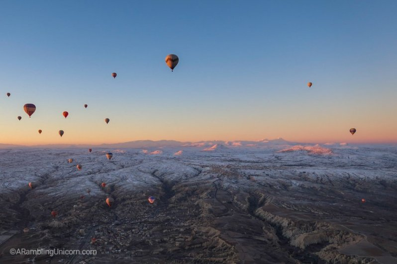 After the sun rises, the balloons are bathed in light.