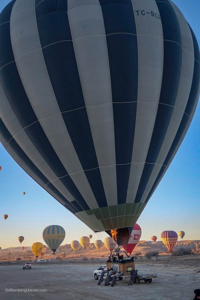 The neighboring balloon lands on a truck.
