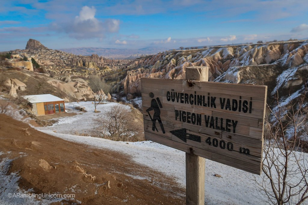 The trailhead for Pigeon Valley Trail with Uçhisar Castle in the background.