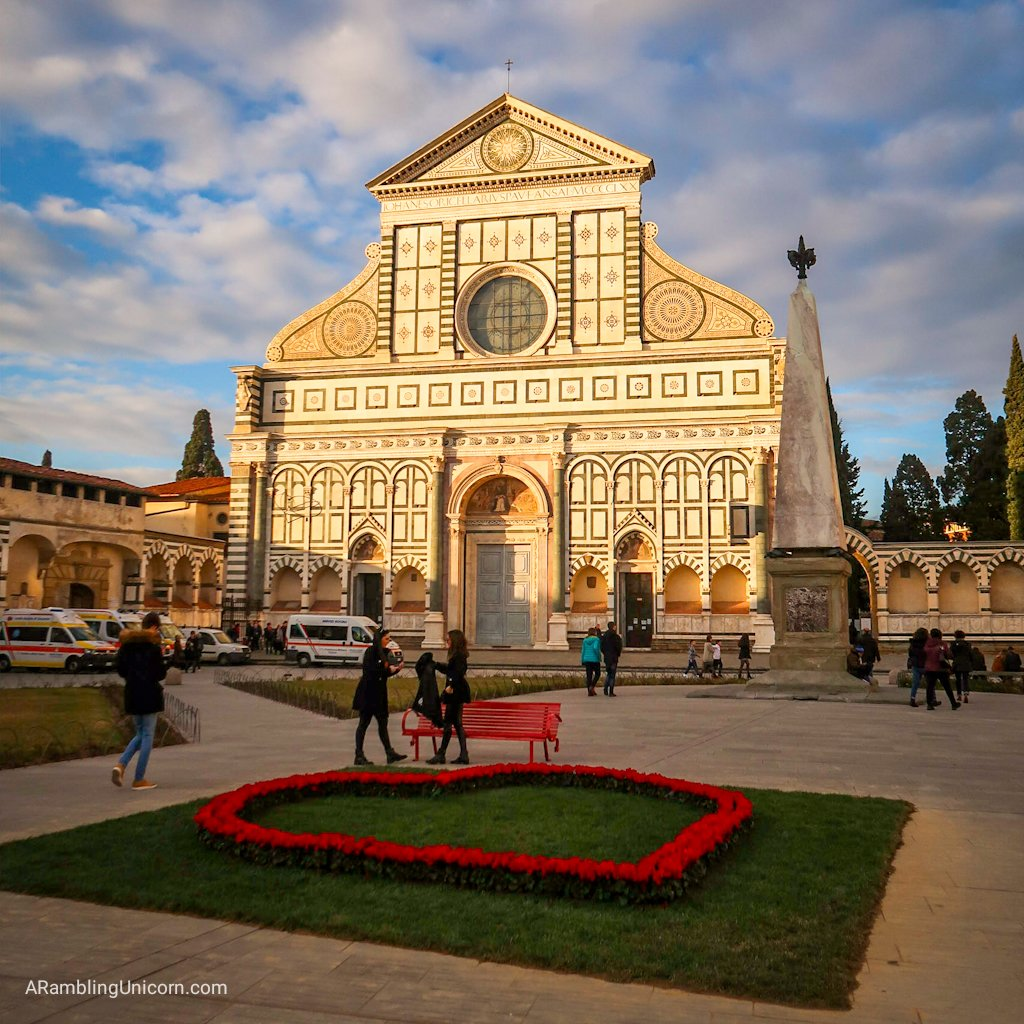 Florence 4 day itinerary: Basilica of Santa Maria Novella. Heart-shaped flowers left over from Valentine's Day decorate the Piazza.