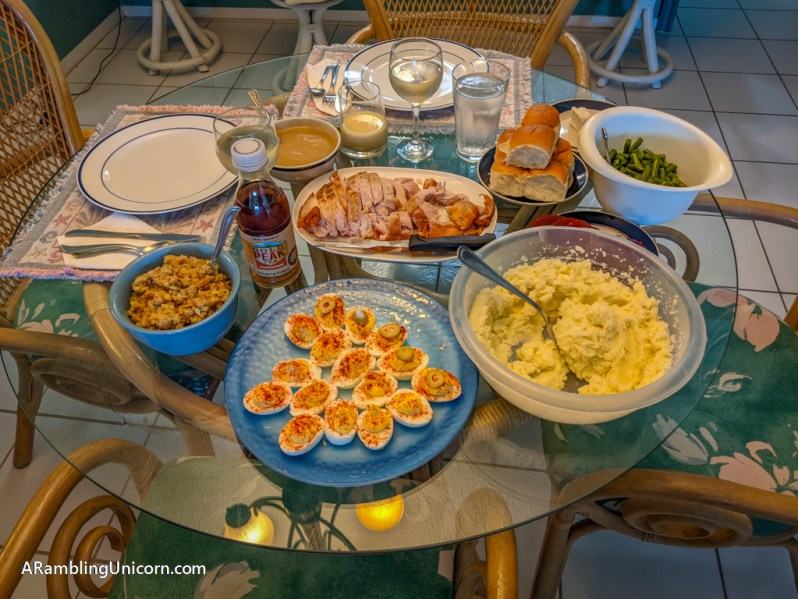 Table laden with food for the Thanksgiving holiday.