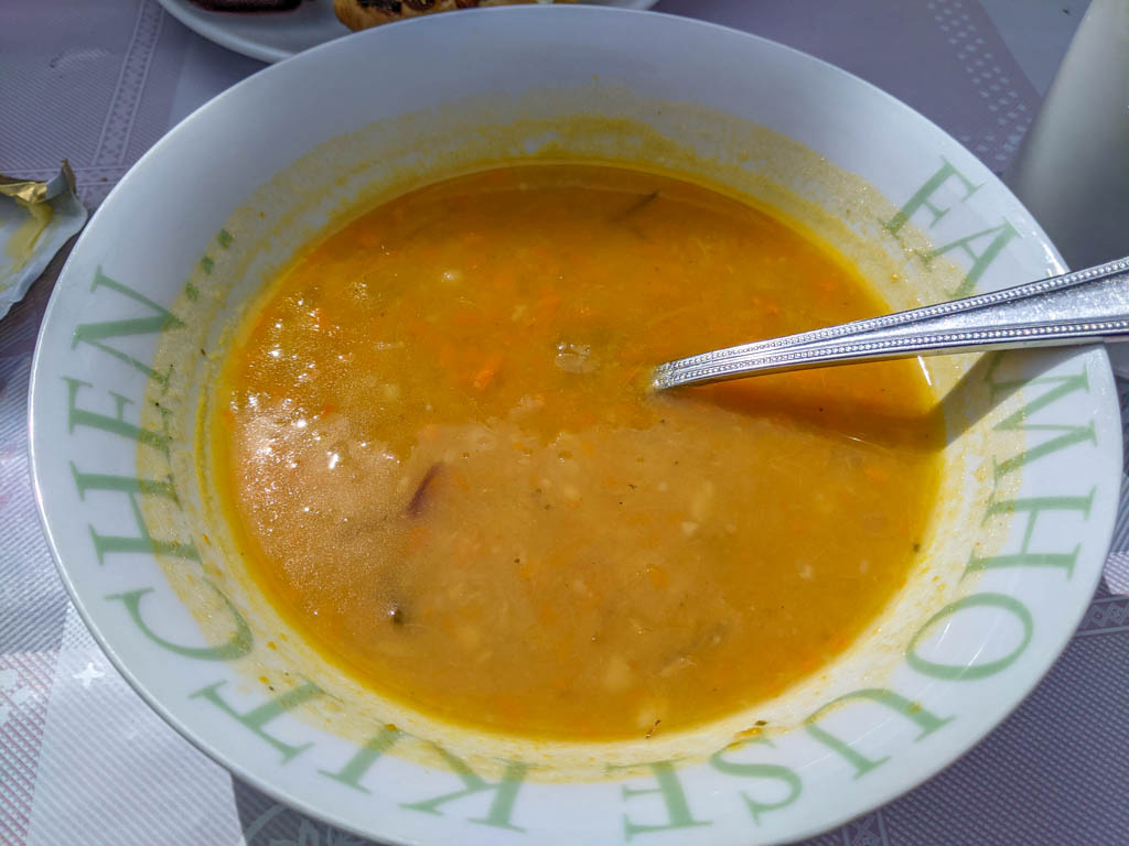 A bowl of creamed vegetable soup with a spoon in it