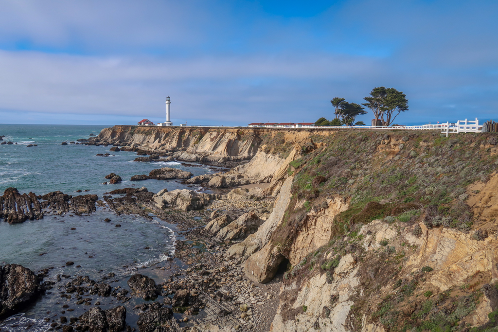 Point Arena Lighthouse stands on the end of a rocky bluff along the coast - a must-do for any Northern California Coast Road Trip