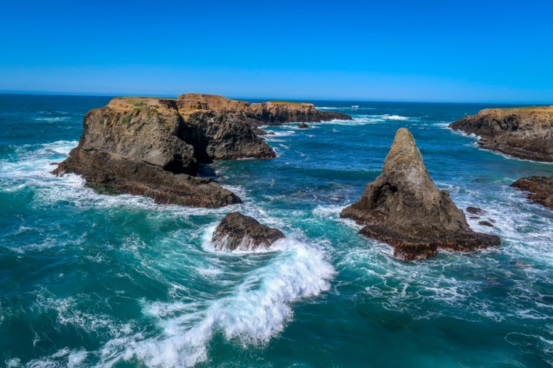 View of the rugged coastline and crashing waves at Mendocino Headlands State Park