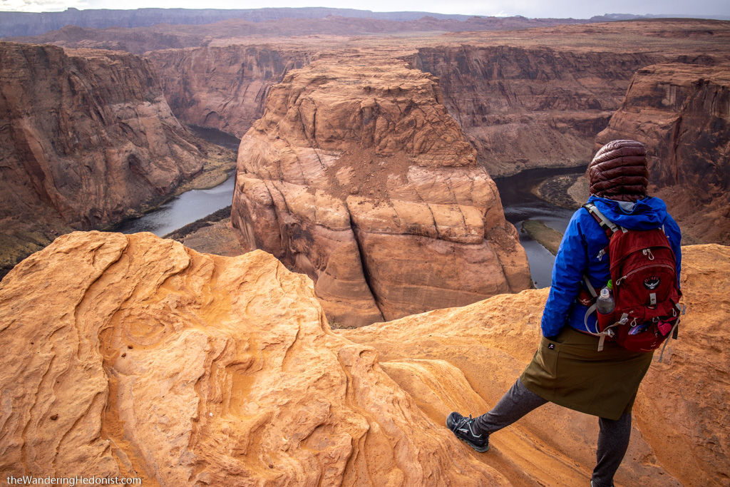 Photo showing the author from the back, standing on the edge of Horseshoe Bend and gazing into the distance.