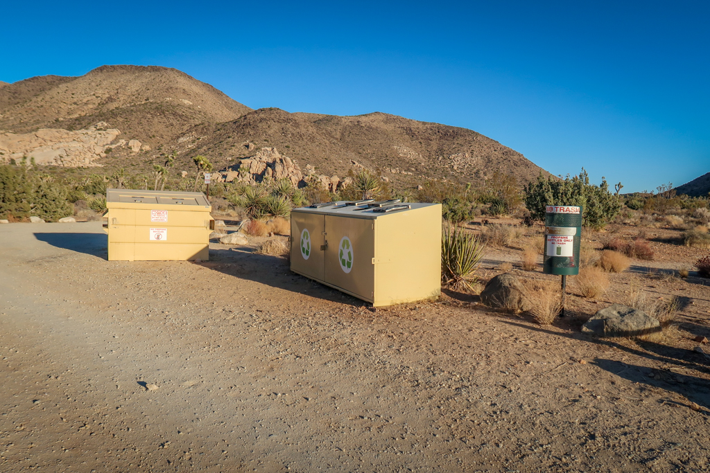 Two large garbage dumpsters and a small garbage can at the Ryan Mountain Campground.